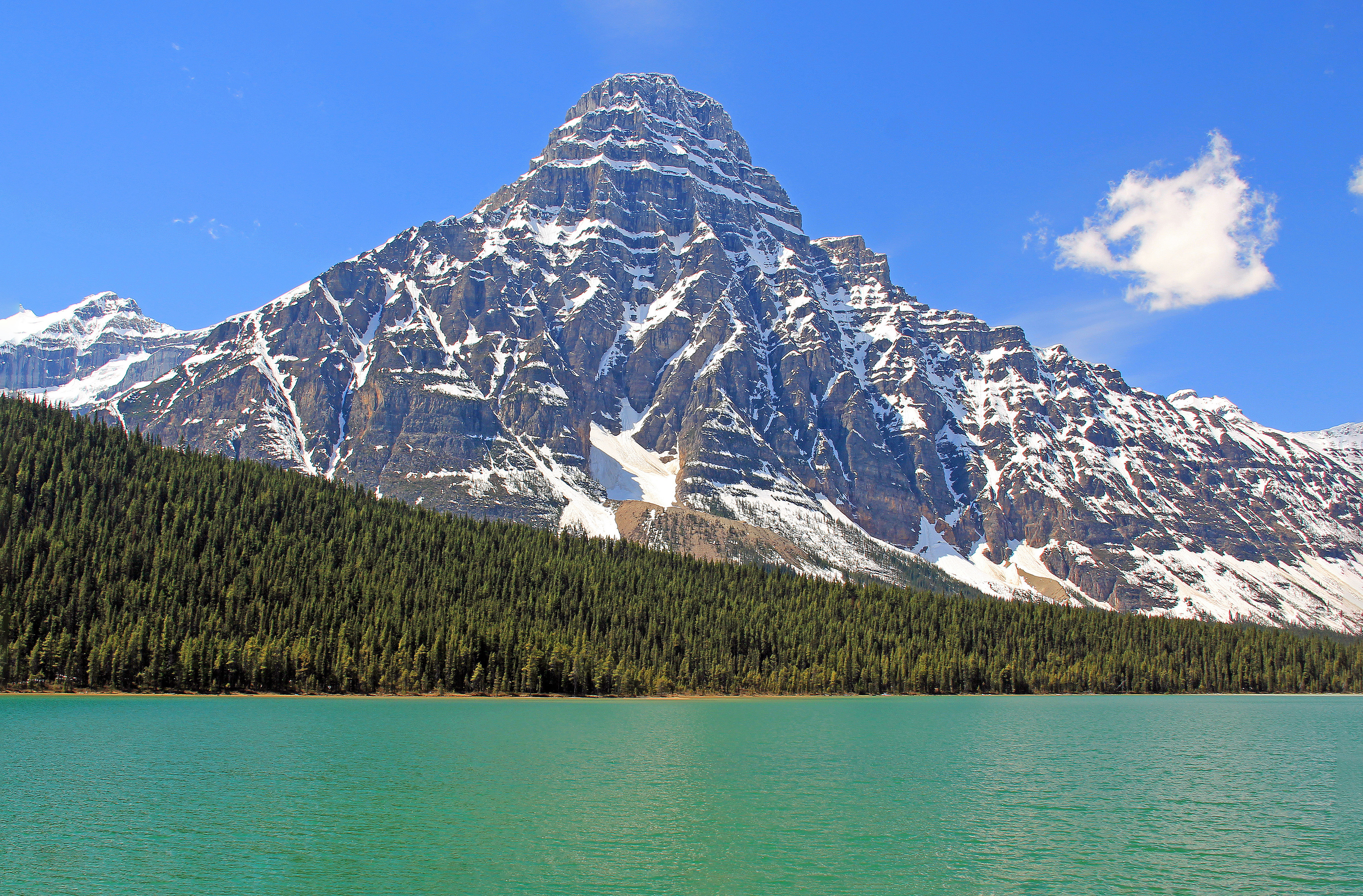 """<p>Icefields Parkway, Banff National Park, AB.</p><p class=""""lightbox-share""""><span>Share: </span><a class=""""lightbox-fb"""" href=""""javascript:void(0);"""">Facebook</a><a class=""""lightbox-twit"""" href=""""https://twitter.com/home?status=I%20voted%20for%20Chephren%20Spire%20in%20the%20Cornice%20Calendar%20Contest.%20Choose%20your%20favourite%206%20photos:%20http://ow.ly/yCSmZ"""" target=""""_blank"""">Twitter</a></p><input type=hidden class=voteid value=1879 />"""